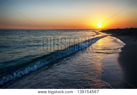 Setting sun on the coast in summer evening