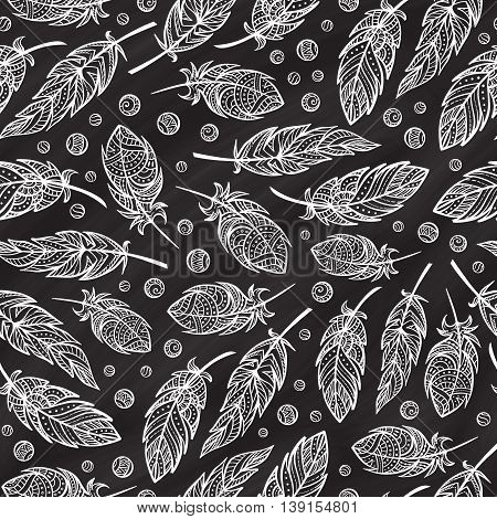 Vector zendoodle feathers seamless pattern on a chalkbord background. Boho style.