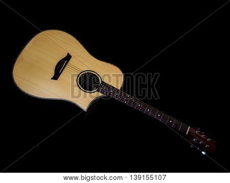 acoustic guitar on black background, spruce wood