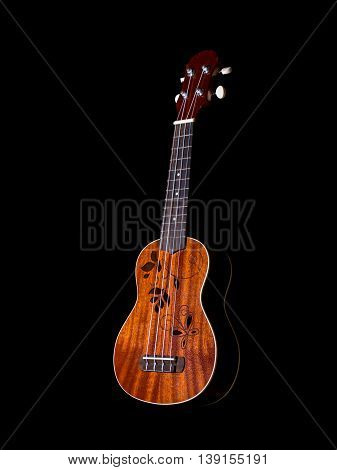 hawaii ukulele guitar isolated against black background flower sound hole