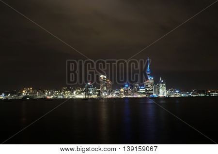 Auckland cityscape at cloudy night, long exposure
