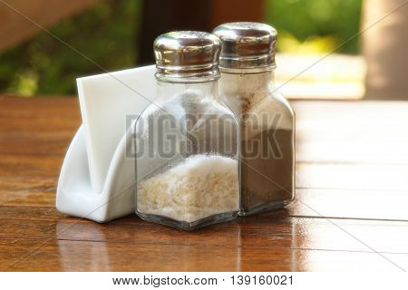 On the table napkins and salt and pepper