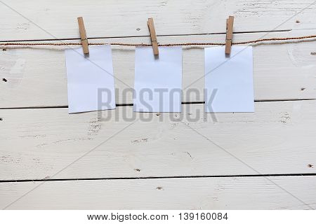 Note pad and cloth pin hanging on string