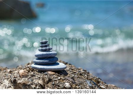 A small Zen out of a pile of stones on a rockStone balance
