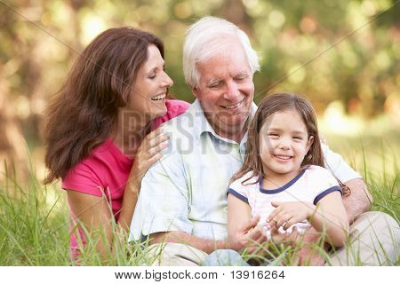 Grandfather With Daughter And Granddaughter In Park