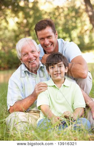 Grandfather With Son And Grandson In Park