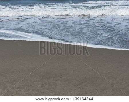 Wave of the sea on the sand beach. Forte dei marmi Province of Lucca Italy
