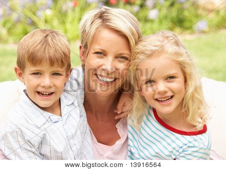Mother And Children Relaxing In Garden