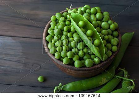 Green Peas In A Ceramic Bowl