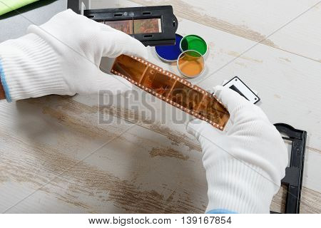 a technician scan a negative film for photo