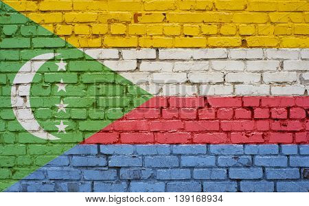 Flag of Comoros painted on brick wall background texture