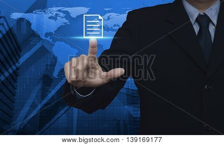 Businessman pressing document icon over map and city tower Elements of this image furnished by NASA