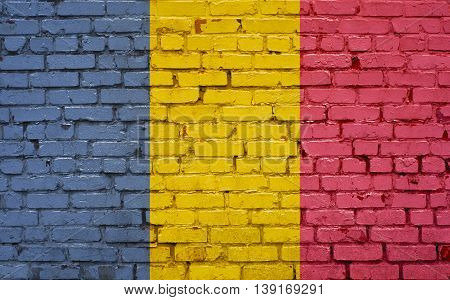 Chad flag painted on old brick wall