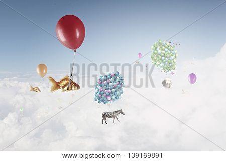 Goldfish fly on balloon . Mixed media
