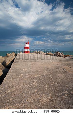 Lighthouse on the Tavira Island before storm AlgarvePortugal