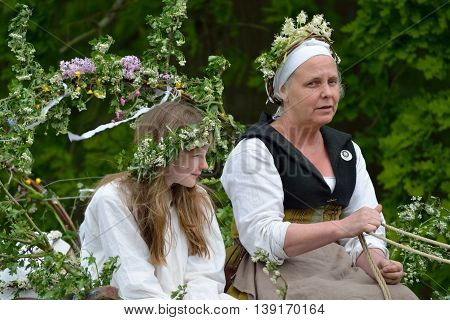 Kentwell Hall England United Kingdom - May 05 2014:May Queen and her escort in medieval May Day parade