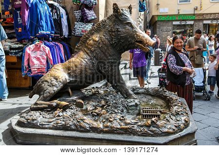 FLORENCE, ITALY - AUGUST 25, 2015. Famous bronze boar at Mercato Nuovo (market) in Florence, Tuscany, Italy.