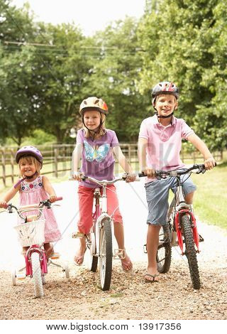 Children In Countryside Wearing Safety Helmets
