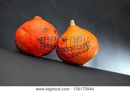 Halloween symbol. Pair Pumpkin heads on dark background with free space