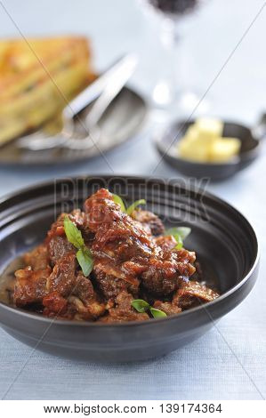 Stewed minced beef in asian style in black bowl
