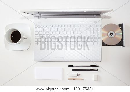 Laptop With Cd, Coffee And Other Accessories