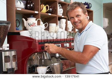Man Making Coffee In Cafe