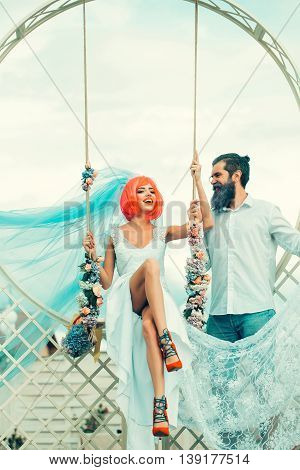 Young Couple Of Bride Woman And Bearded Man