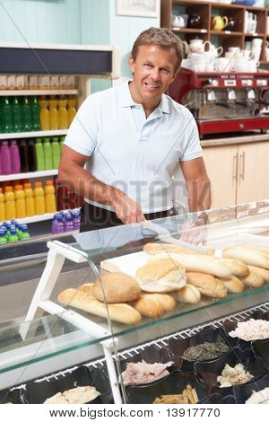 Man Working Behind Counter In Cafe