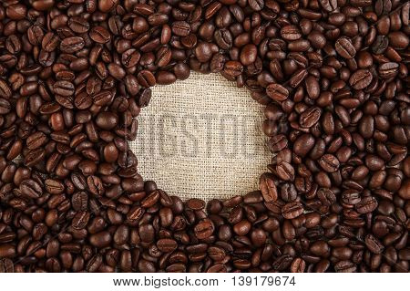 Photo  Of Coffee Beans On Hessian Textile Background
