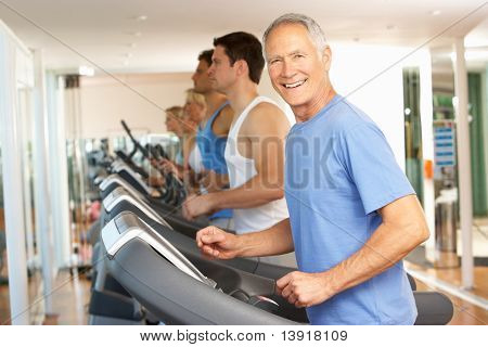 Senior Man On Running Machine In Gym