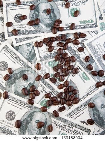 Coffee Beans Scattered On Dollar Price Of Coffee Photo
