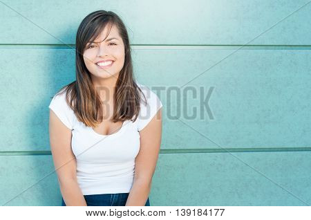 Attractive Lady Posing And Smiling With Casual Look