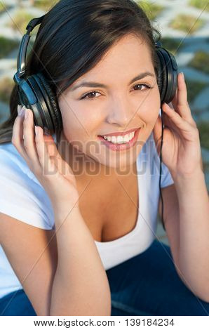 Portrait Of Girl Listening To Music On Headphones