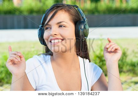Beautiful Girl Having Fun In Park Listening To Music
