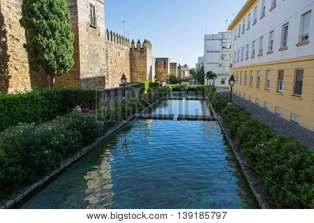 CORDOBA, SPAIN - OCTOBER 24th, 2014: City walls beside Almodovar gate (Puerta del Almodovar), huge medieval walls from the 14th century in Cordoba, Spain