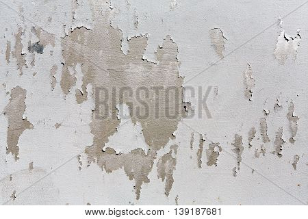 Rustic shabby painted metal texture abstract background. Weathered surface of gray iron damaged grunge wall with old paint spots.