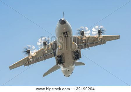 FARNBOROUGH, UK - JULY 14: Closeup of an Airbus A400M military transporter aircraft in a steep climb after take-off from Farnborough, Hampshire, UK on July 14, 2016