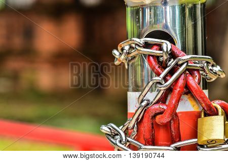 Two padlock with red chains and steel