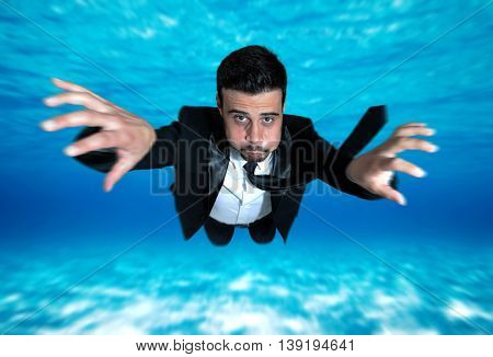 Businessman swimming in the ocean