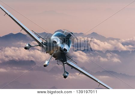 Privat light airplane or aircraft fly on mountain background. Travel concept.