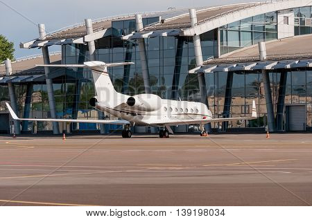 Airplane, view on airport terminal. Travel and business concept background.