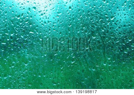 Rainy wet cold blue eco seasonal natural blurred background with water drops