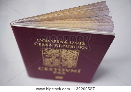 Red Czech passport with a state symbol (lions and eagles) and captions Czech Republic and European Union in Czech language