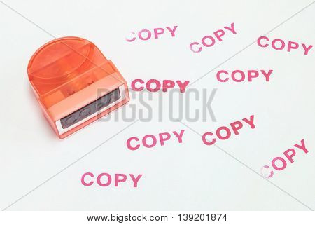 Closeup the pump rubber stamp in copy word with red ink copy word on white paper textured background