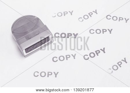 Closeup the pump rubber stamp in copy word with ink copy word on white paper textured background in black and white tone
