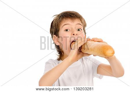 Happy boy eating French bread with appetite. Isolated over white.