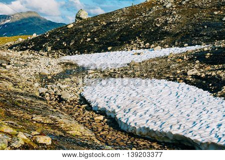 Beautiful Landscape Of Norwegian Mountains. Summer Snow. Nature Of Norway. Travel And Hiking. Sunny Summer Day. Nobody. Scandinavia