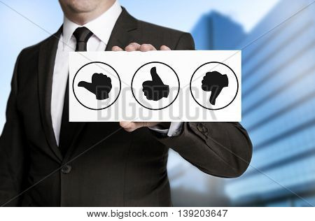 Thumbs Concept Placard Is Held By Businessman