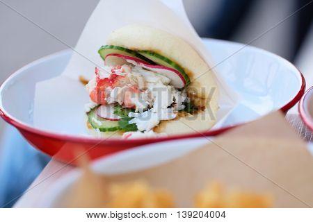 Lobster roll sandwich in outdoor restaurant