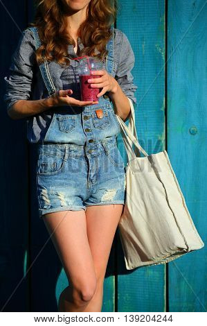Woman Hipster With Linen Bag Keep In Their Hands Disposable Cup With Smoothies